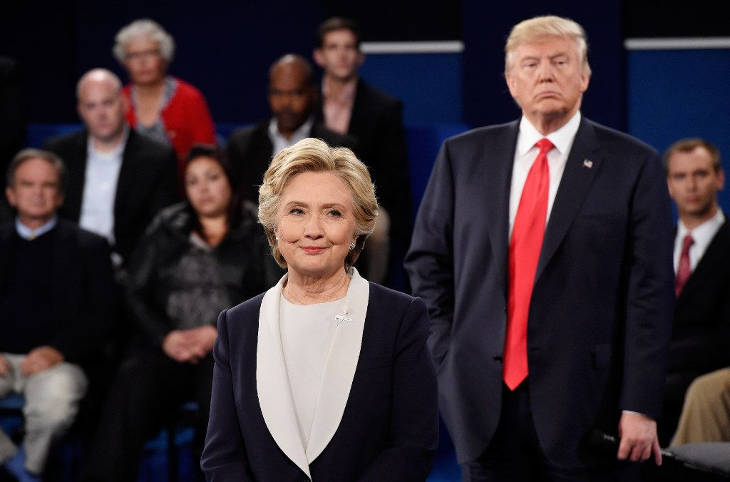 Hillary Clinton and and Donald Trump listen during the town hall debate at Washington University in St. Louis. (Saul Loeb/Getty Images)