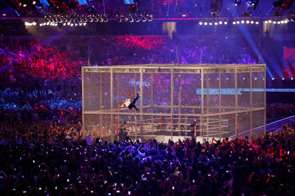Shane McMahon attempts to jump from the top of the cage onto The Undertaker in the Hell In A Cell event during WrestleMania 32 at AT&T Stadium in Arlington, TX, Sunday, April 3, 2016. The Undertaker was able to dodge the jump. (David Guzman/The Dallas Morning News)