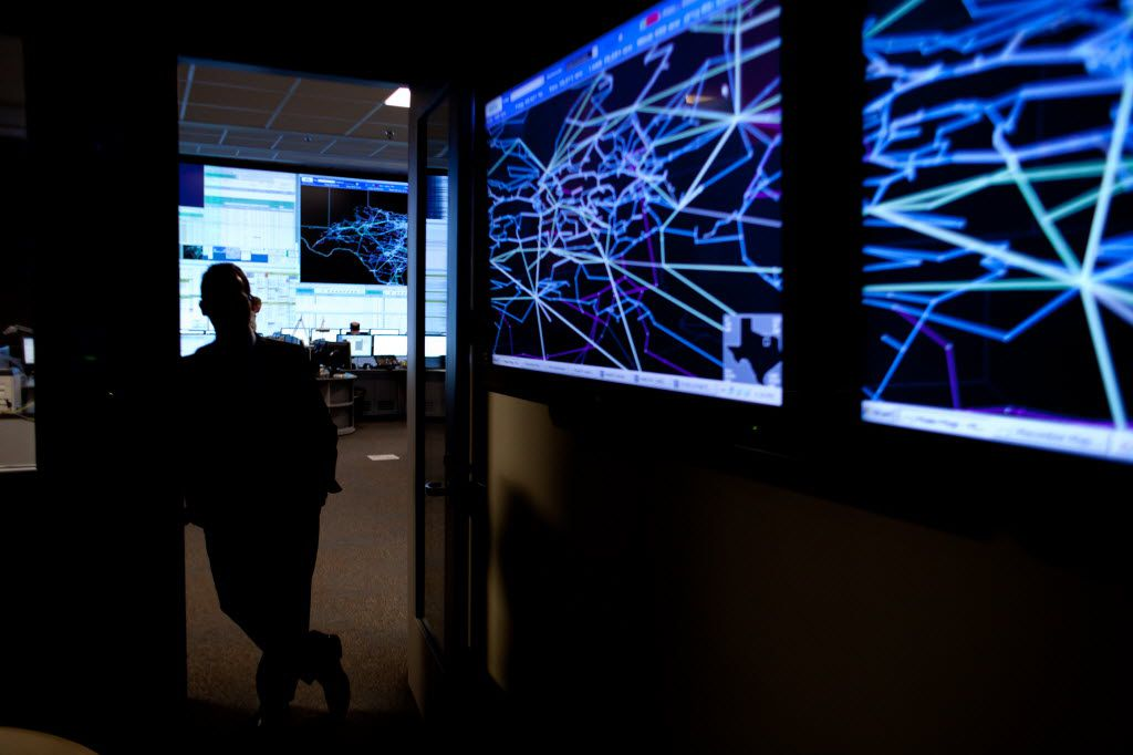 Screens display the power grid of the Dallas-Fort Worth area in the conference room of the Electric Reliability Council of Texas' control center in Bastrop. (2011 File Photo/Julia Robinson)