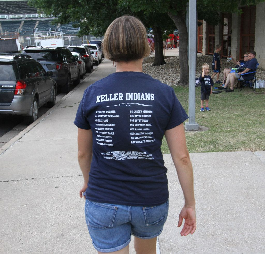 A Keller Indians softball supporter made her way toward the front gate as part of a large contingency that made the trip to Austin in June to support the Indians in their quest for back-to-back state championships. Keller defeated Austin Bowie to win the title.