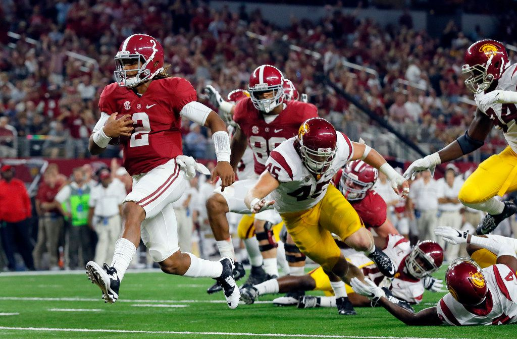 FILE - In this Sept. 3, 2016, file photo, Alabama quarterback Jalen Hurts slips into the end zone on a 7-yard touchdown run during the second half of an NCAA college football game against Southern California, in Arlington, Texas. Freshman Jalen Hurts was picked as the offensive player of the year of The Associated Press All-Southeastern Conference team announced Thursday, Dec. 8, 2016. (AP Photo/Tony Gutierrez, File)