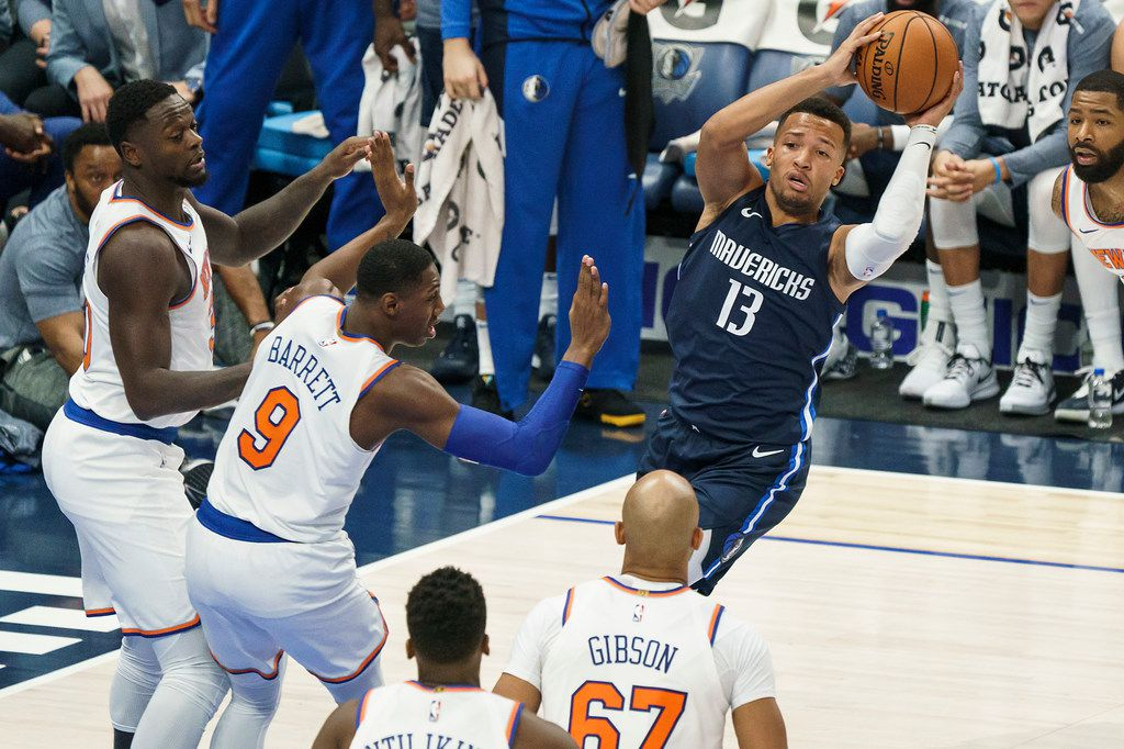 Dallas Mavericks guard Jalen Brunson (13) looks to pass around New York Knicks guard RJ Barrett (9) and forward Taj Gibson (67) during the first half of an NBA basketball game at American Airlines Center on Friday, Nov. 8, 2019, in Dallas. (Smiley N. Pool/The Dallas Morning News)