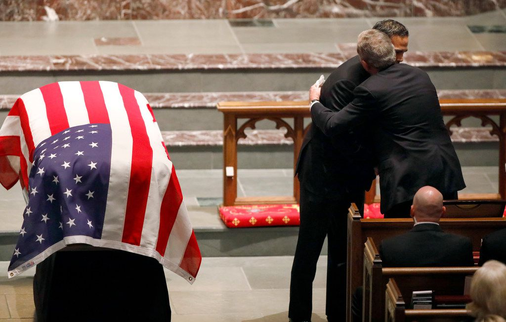 Former President George W. Bush gives his nephew George P. Bush a hug following his eulogy during the funeral service of George H.W. Bush, the 41st President of the United States, at St. Martin's Episcopal Church in Houston, Thursday, December 6, 2018.