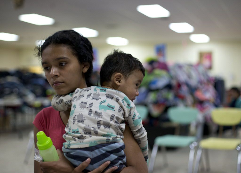 Rosa Danubia Maldonado of Honduras held her child at the Sacred Heart Catholic Church in McAllen in January. Maldonado, 18, was processed by U.S. immigration authorities, who placed a monitor on her ankle before she was allowed to leave. (File Photo/The Associated Press)