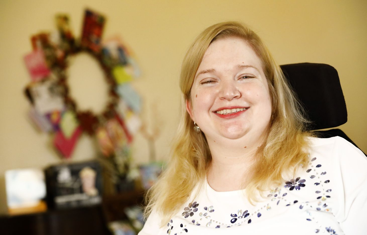 Jessica Lukefahr of Kingsville was denied a standing wheelchair, which helps her hold a voluntary job at the Corpus Christi Museum and relieves pain.