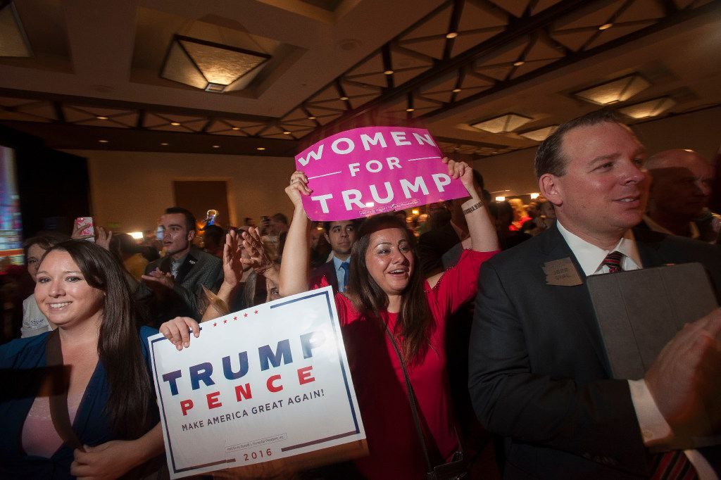 Supporters of Republican candidate Donald Trump cheer as election results come in during a viewing party at a hotel in downtown Phoenix.