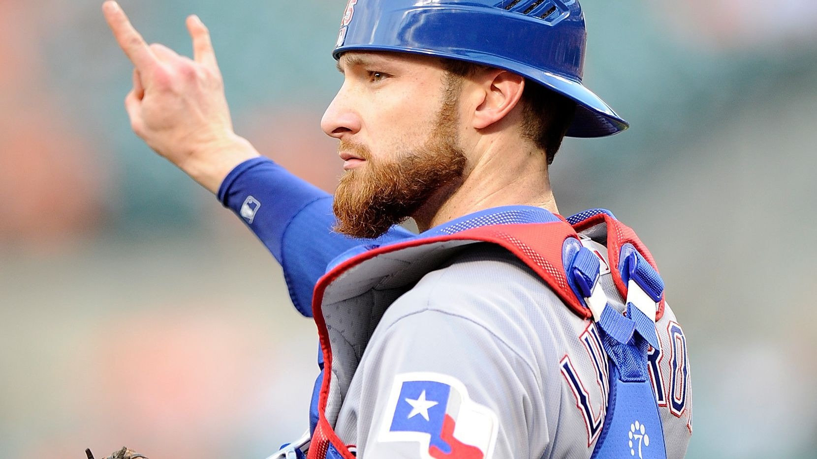 BALTIMORE, MD - AUGUST 02:  Jonathan Lucroy #25 of the Texas Rangers motions that there are two outs in the second inning against the Baltimore Orioles at Oriole Park at Camden Yards on August 2, 2016 in Baltimore, Maryland.  (Photo by Greg Fiume/Getty Images)