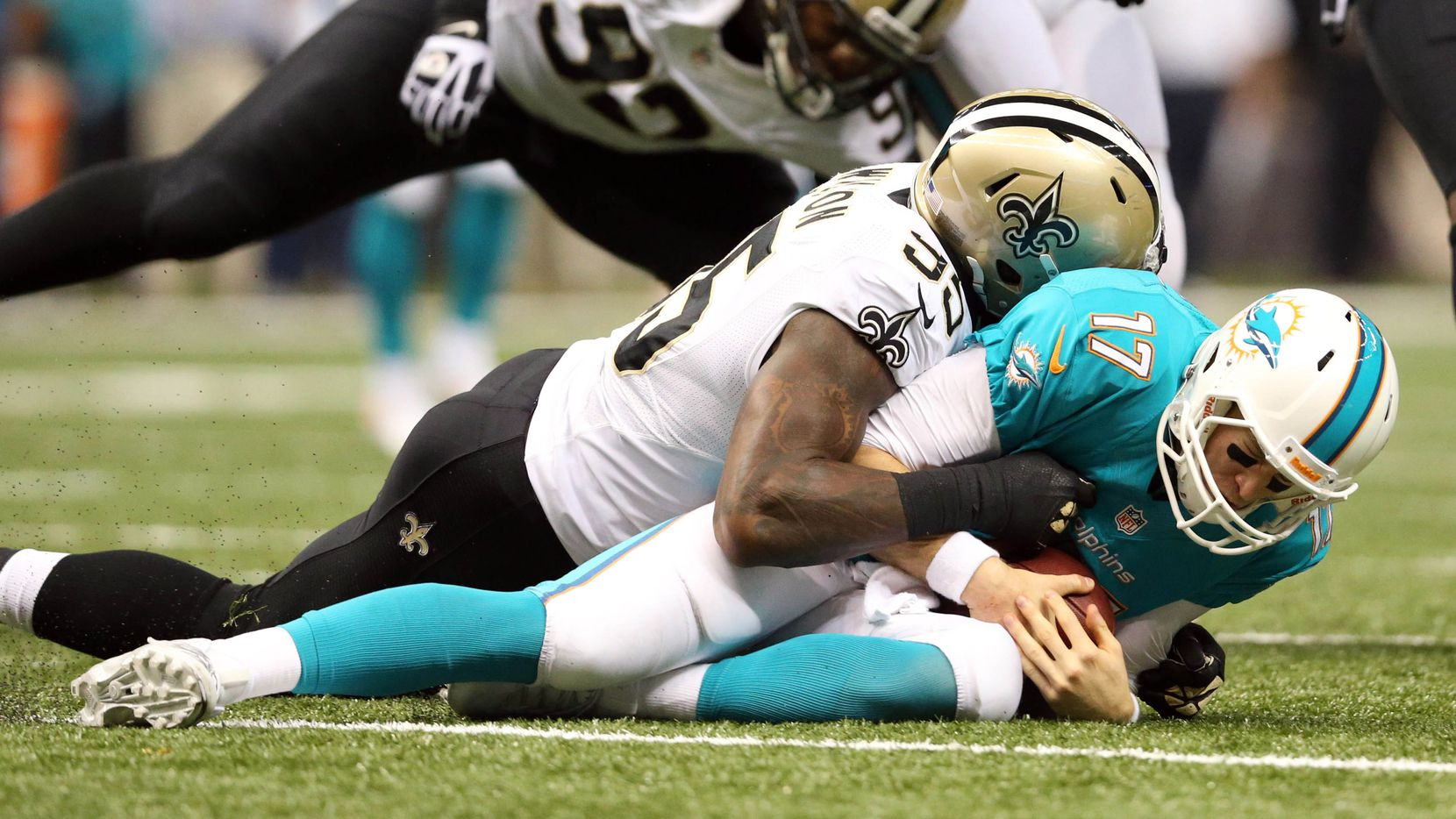 Sep 30, 2013; New Orleans, LA, USA; Miami Dolphins quarterback Ryan Tannehill (17) is sacked by New Orleans Saints linebacker Martez Wilson (95) in the third quarter at Mercedes-Benz Superdome. Mandatory Credit: Crystal LoGiudice-USA TODAY Sports