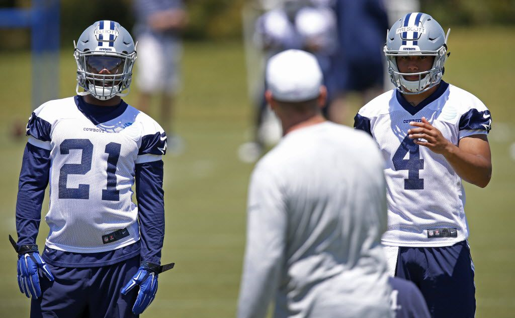 Cowboys rookie running back Ezekiel Elliott (21) and quarterback Dak Prescott (4) watches Offensive Coordinator Scott Linehan during the Dallas Cowboys rookie minicamp at Valley Ranch in Irving, Texas, Friday, May 6, 2016. (Jae S. Lee/The Dallas Morning News)