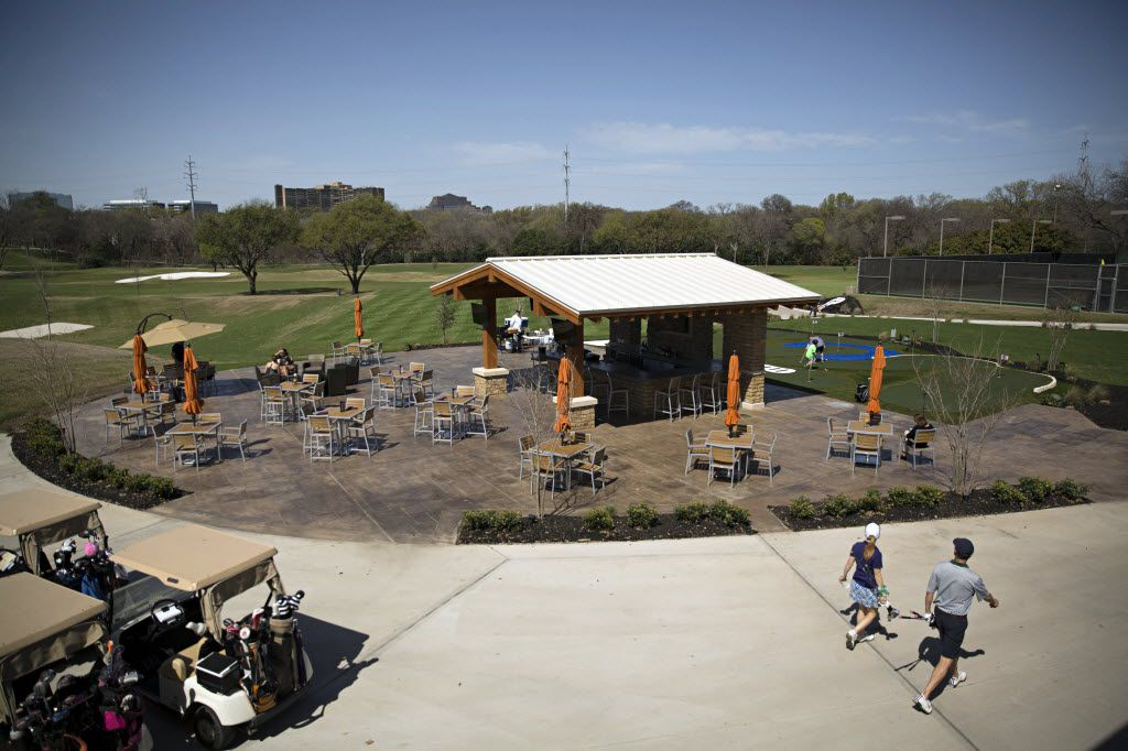 An outdoor seating area sits near the golf course at The Clubs of Prestonwood. (File Photo/Staff)