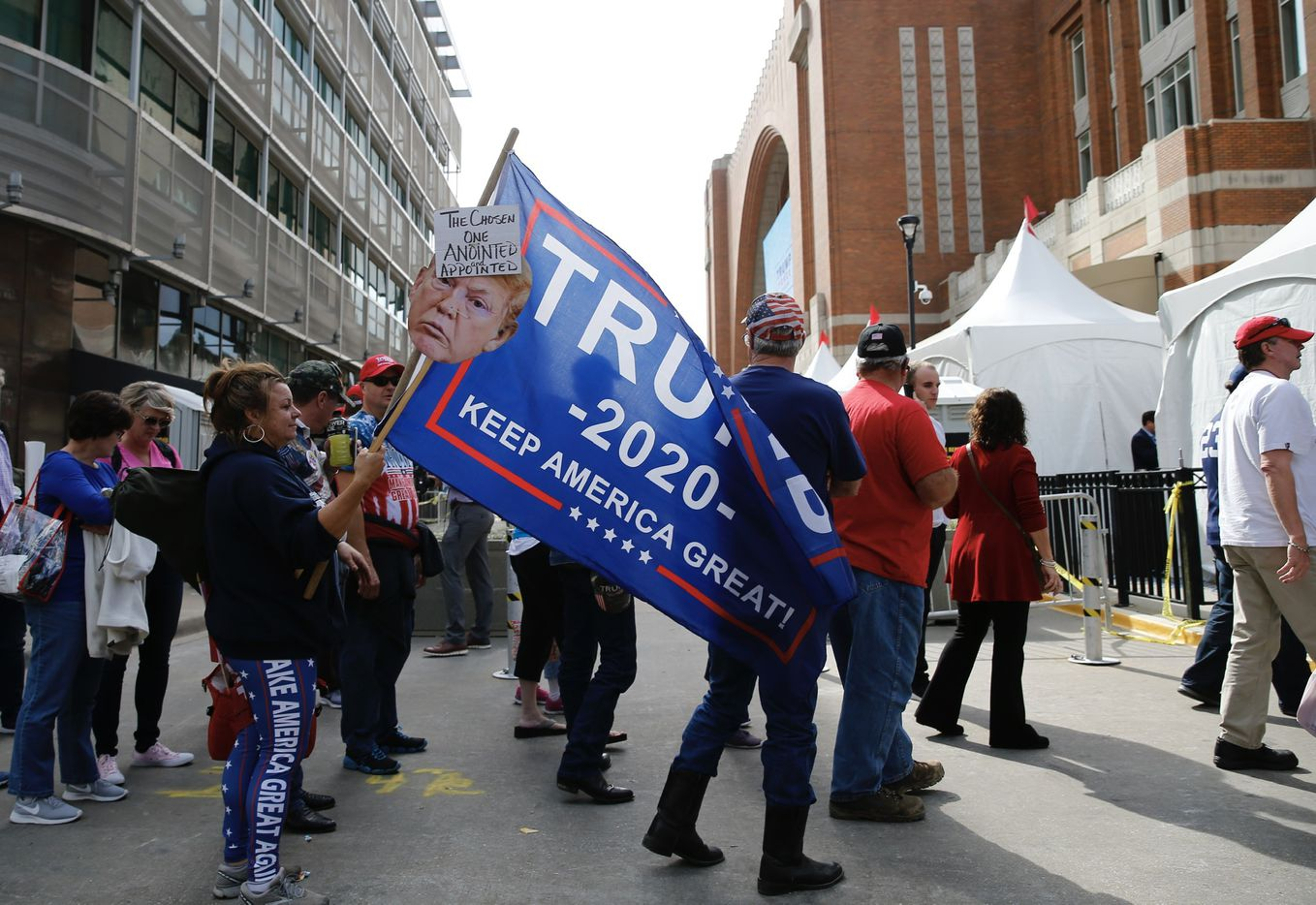 People wait in line for the Keep America Great Rally for President Donald Trump at the American Airlines Center in Dallas, on Thursday, October 17, 2019.