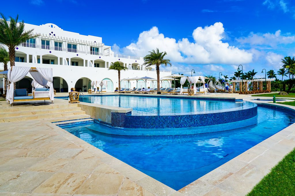 Relax poolside at Cuisinart Golf Resort and Spa, or head to Anguilla's fabulous white-sand beaches.