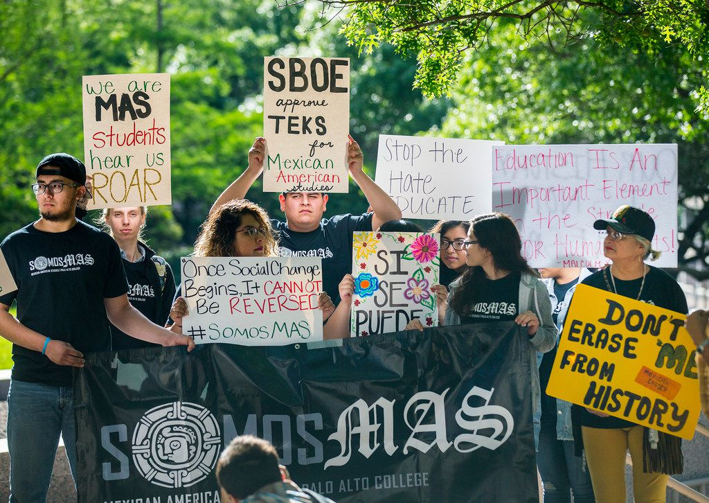 People rally in front of the State Board of Education building before a preliminary vote on whether to create a statewide Mexican American studies course during a public hearing on Wednesday, April 11, 2018, in Austin (Ricardo Brazziell/Austin American-Statesman via AP)