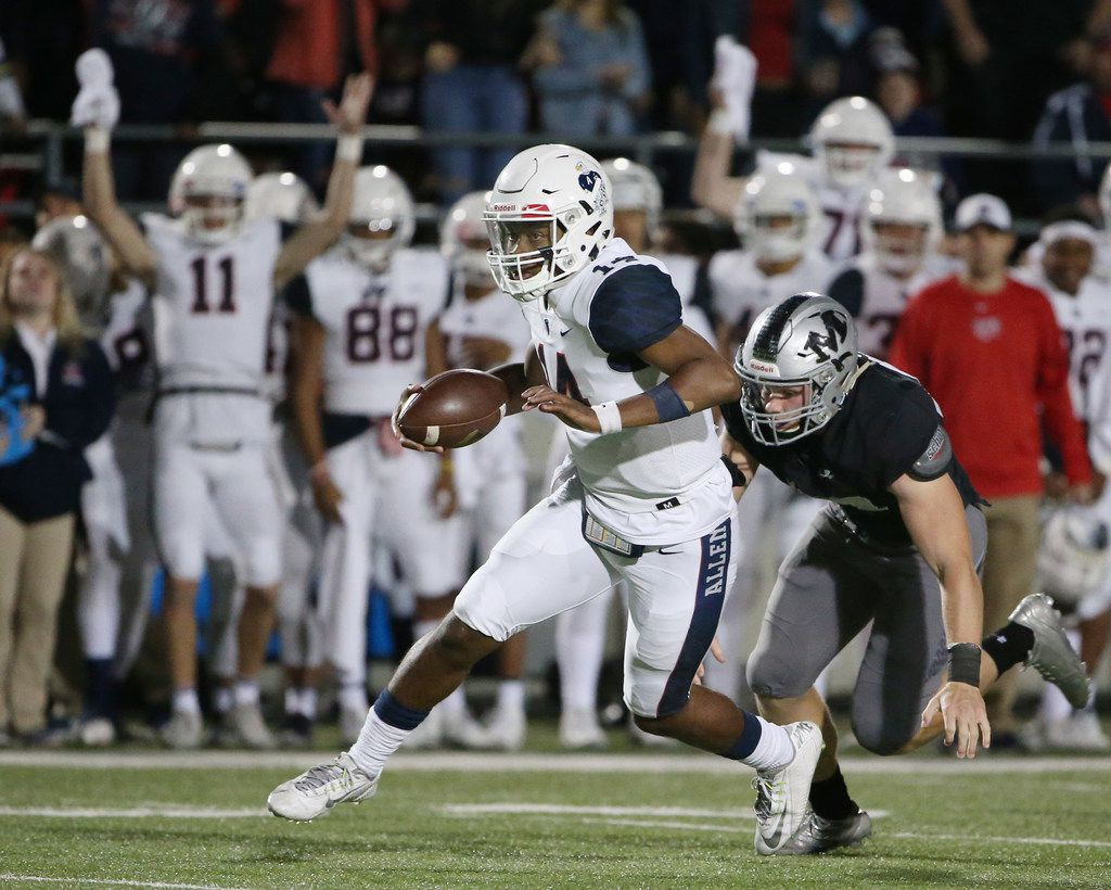 Allen quarterback Grant Tisdale (14) runs with the ball in the second quarter while outrunning a tackle by Arlington Martin defensive end Dylan Ford (97) during the Class 6A Division 1 Region 1 semifinal high school playoff game between Arlington Martin and Allen at Dragon Stadium in Southlake, Texas Friday December 1, 2017. (Andy Jacobsohn/The Dallas Morning News)