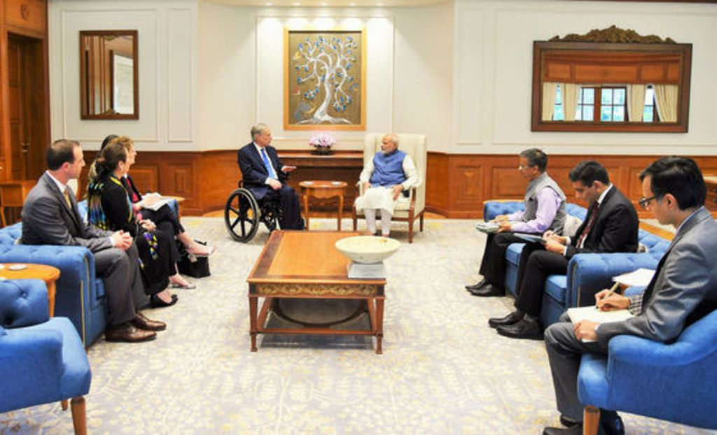 """David Whitley (left) was the only non-security aide with Texas Gov. Greg Abbott and first lady Cecilia Abbott, next to Whitley, when the governor met with Indian Prime Minister Narendra Modi in New Delhi, India., in March 2018. Whitley called it """"one of those moments"""" he'll always remember."""