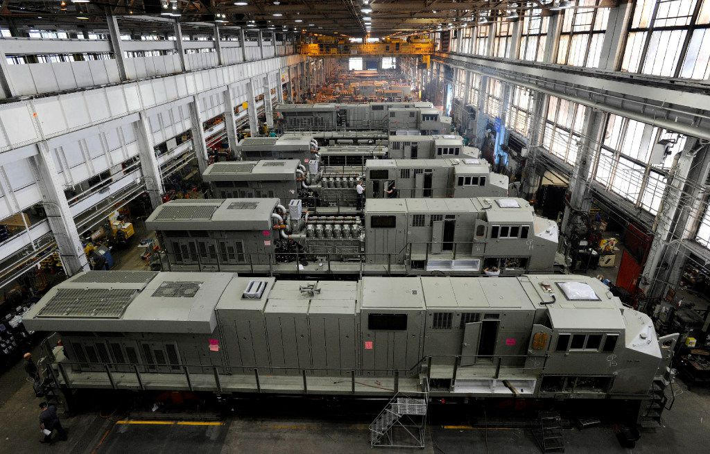 This 2011 photo shows General Electric Evolution Series locomotives being assembled in Building 10 at GE Transportation in Lawrence Park Township, Erie County, Pa. Plant officials announced Thursday, July 27, 2017, that, after more than 100 years of production at the Erie-area plant, locomotive production, except for prototypes, would be eliminated from Erie by the end of 2018. All locomotive production is being transferred to GE Transportation's Fort Worth, Texas, plant. (Christopher Millette/Erie Times-News, via AP)