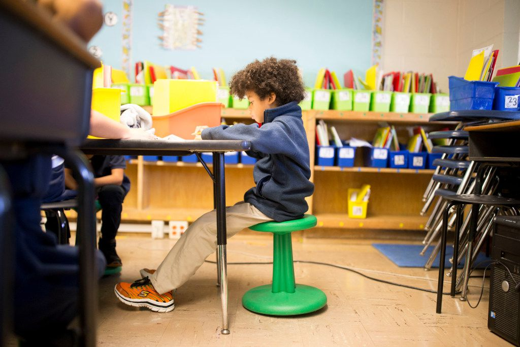 Jaxon Youngblood, 7, sits on a wobble stool donated through DonorsChoose.org at Hexter Elementary. (Ting Shen/Staff Photographer)