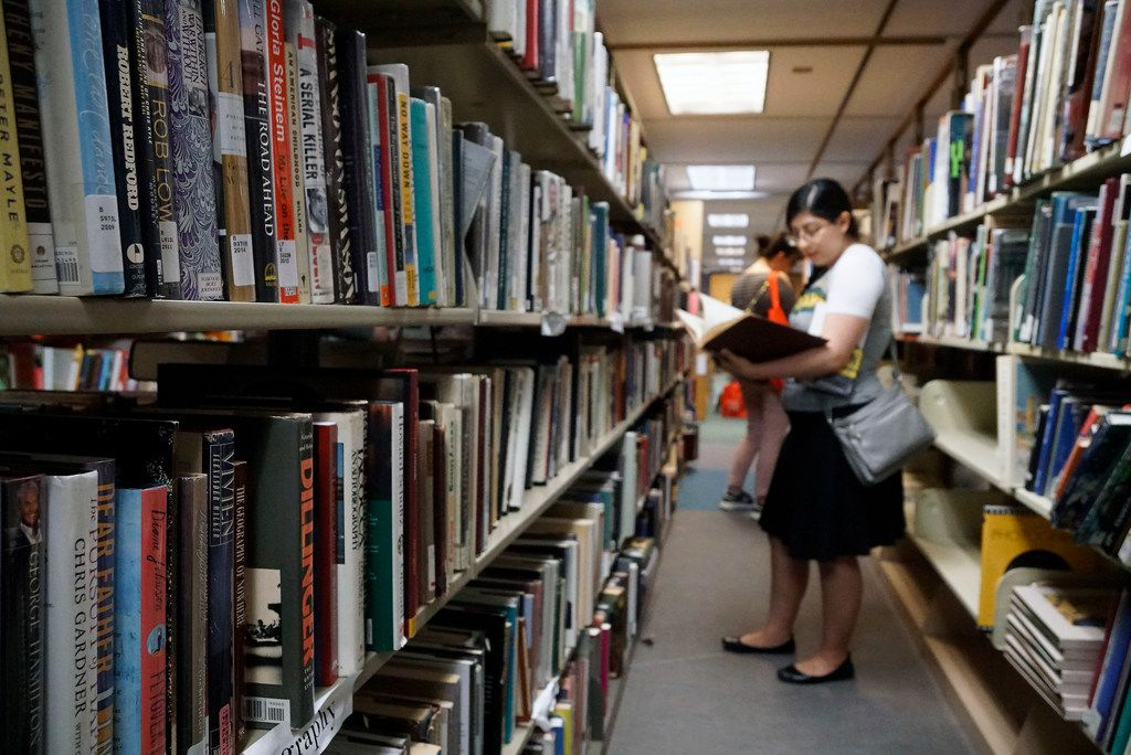 Priscilla Escobedo peruses the bookshelves during the Summer in the City discussion as part of the Dallas Festival of Books at the Dallas Public Library on June 1, 2019. (Lawrence Jenkins/Special Contributor)