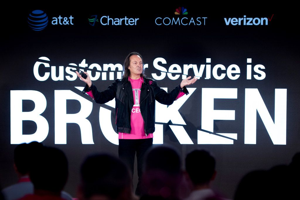 T-Mobile Chief Executive Officer John Legere addresses the audience at T-Mobile's Un-carrier NEXT event at the T-Mobile Customer Experience Center on Wednesday, August 15, 2018 in Charleston, S.C. (Sean Rayford/AP Images for T-Mobile)