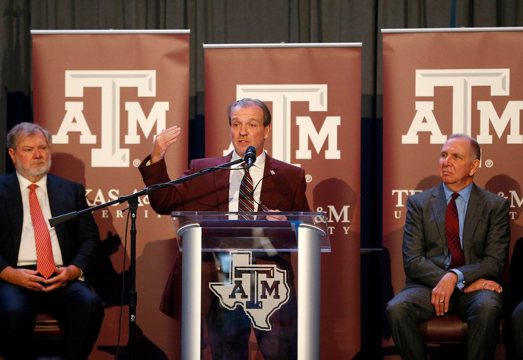 FILE - Texas A&M's new coach Jimbo Fisher next to A&M president Michael K. Young (right) during a press conference at Kyle Field in College Station, Texas on Dec. 4, 2017.  (Nathan Hunsinger/The Dallas Morning News)