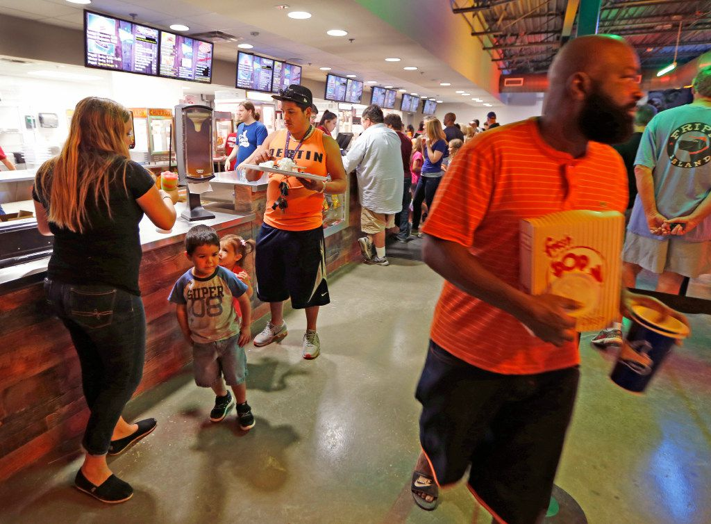 Movie goers buy concessions at the Coyote Drive-In in Lewisville, Texas, photographed on Saturday, October 29, 2016. (Louis DeLuca/The Dallas Morning News)
