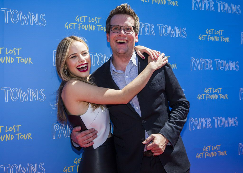 Actress Halston Sage and author John Green pose for photos on the red carpet outside a promotional event for Paper Towns, a movie based on the book by John Green, on Thursday, July 16, 2015 at Bomb Factory in Dallas.
