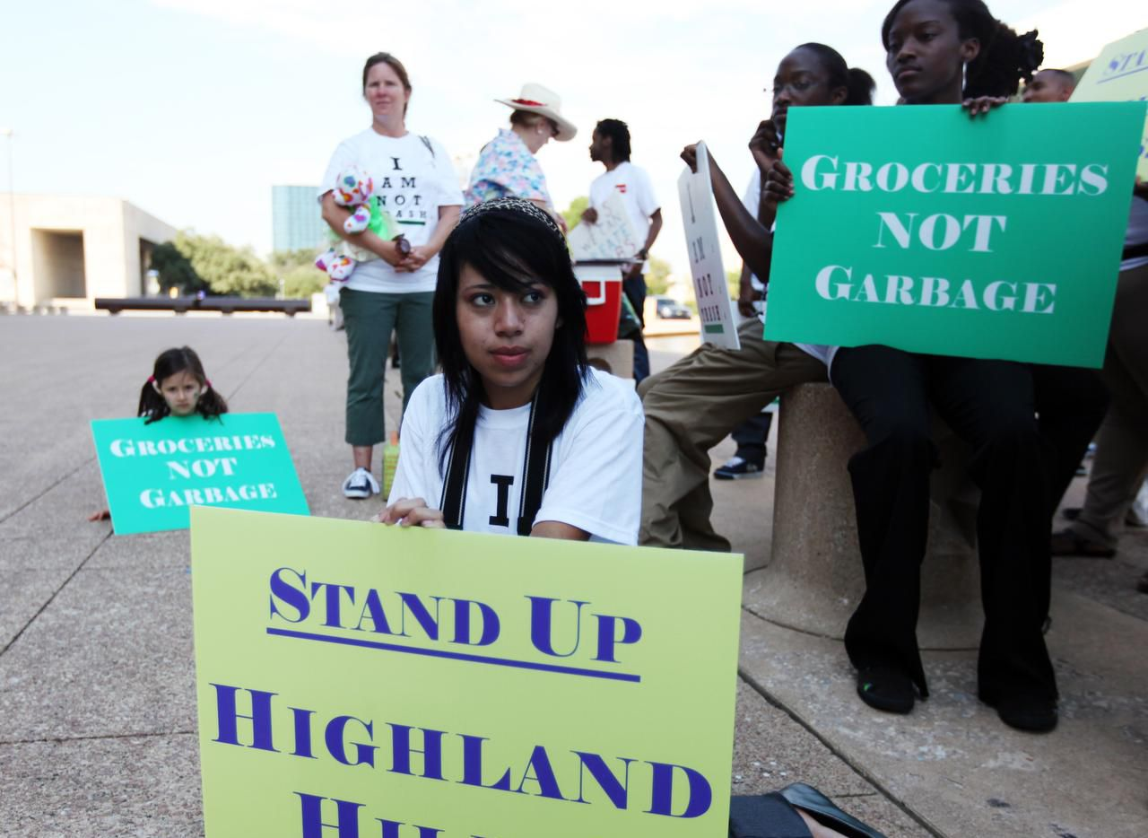 Paul Quinn College students joined other protesters in September 2011 in front of Dallas City Hall to protest a city plan to expand a landfill near the campus. The successful campaign to stop the expansion sparked a partnership between Paul Quinn and Duke University's Nicolas School of the Environment.