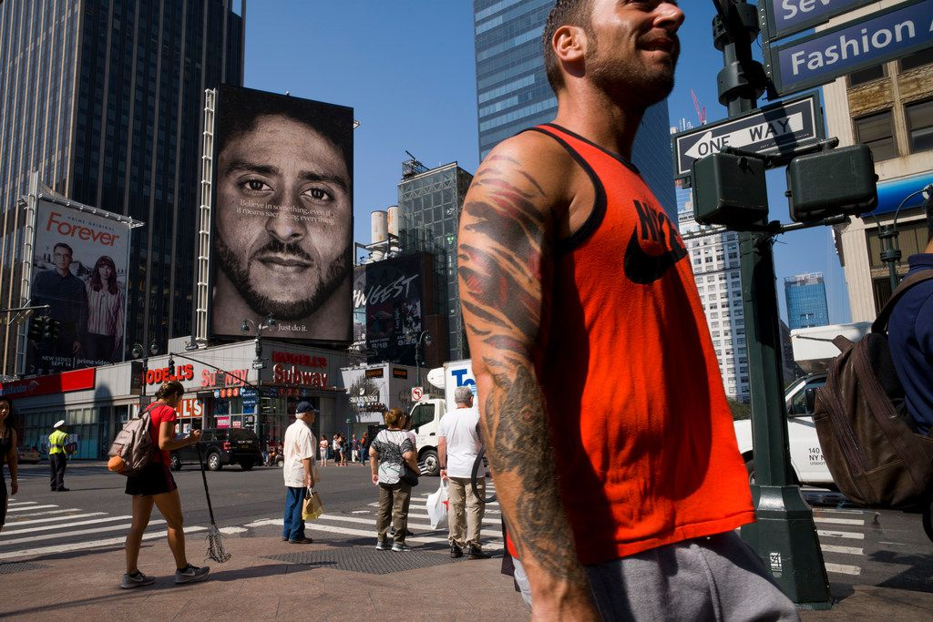 A Nike advertisement featuring Colin Kaepernick is on display Sept. 6 in New York. Nike recently unveiled the deal with the former San Francisco 49ers quarterback, who's known for starting protests among NFL players over police brutality and racial inequality. (AP Photo/Mark Lennihan)