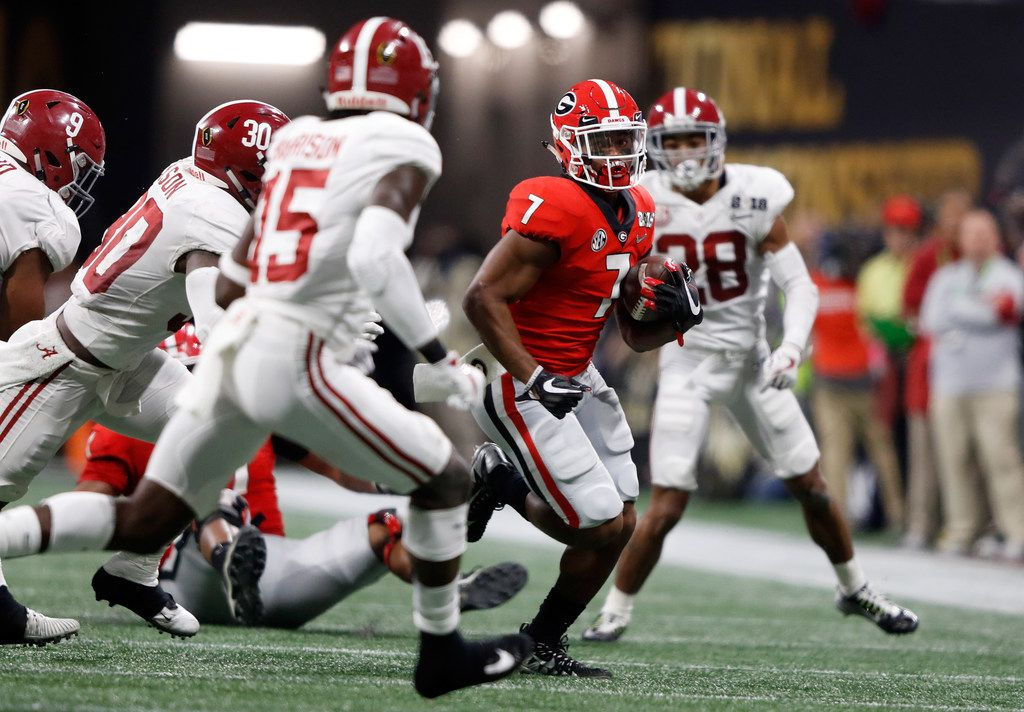 ATLANTA, GA - JANUARY 08: D'Andre Swift #7 of the Georgia Bulldogs runs the ball during the second quarter against the Alabama Crimson Tide in the CFP National Championship presented by AT&T at Mercedes-Benz Stadium on January 8, 2018 in Atlanta, Georgia.  (Photo by Jamie Squire/Getty Images)