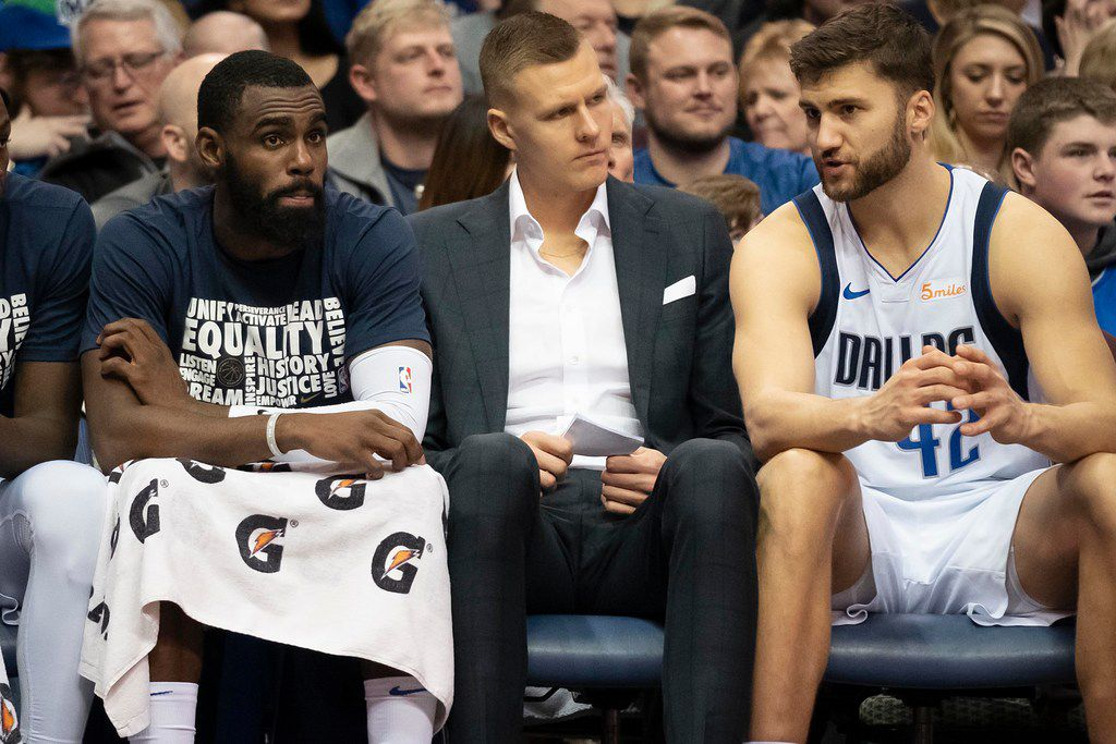 Dallas Mavericks forward Kristaps Porzingis (center) sits on the bench with guard Tim Hardaway Jr. and forward Maximilian Kleber (42) during the second half of an NBA basketball game at American Airlines Center on Sunday, Feb. 10, 2019, in Dallas. (Smiley N. Pool/The Dallas Morning News)