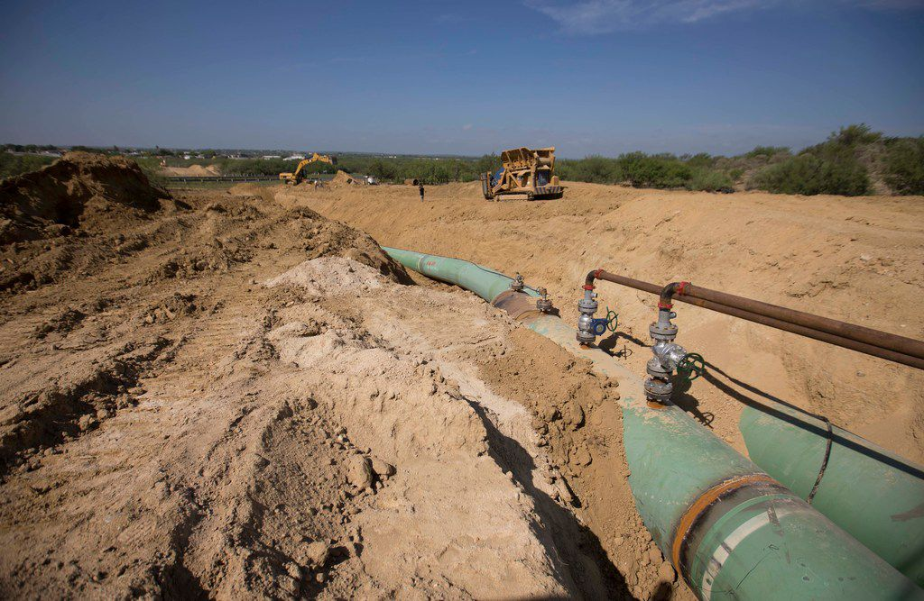 In this Sept. 7, 2014 photo, new pipelines to carry gas from Texas to Mexico, eventually reaching the city of Guanajuato, are laid underground near General Bravo, Nuevo Leon state, Mexico. Mexican President Andres Manuel Lopez Obrador said on Jan.  7, 2019, that he has shut down some pipelines to stop fuel thieves who he says have established an illegal distribution network.