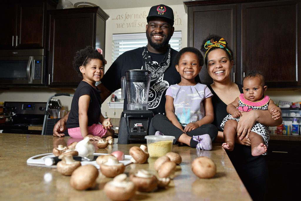 James McGee, owner of the vegan restaurant Peace Love & Eatz in DeSoto, with his family Solstice McGee, 2, left, Captain McGee, 4, wife Morgan McGee and their newborn Phoenix, at their home in DeSoto.