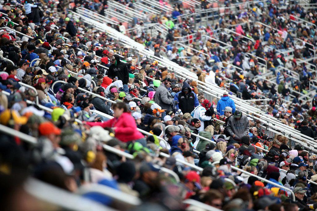 Fans watch the Monster Energy NASCAR O'Reilly Auto Parts 500 at Texas Motor Speedway in Fort Worth, Texas on Sunday, April 8, 2018. Monster Energy NASCAR Cup Series driver Kyle Busch (18) won the series. (Rose Baca/The Dallas Morning News)