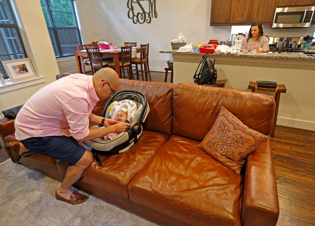 Dallas Independent School District Trustee Miguel Solis unbuckled his daughter Olivia Solis as wife Jacqueline Nortman prepared baby food in the kitchen at their home in Dallas on Tuesday, June 19, 2018.