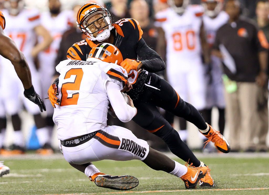 CINCINNATI, OH - NOVEMBER 5:  Leon Hall #29 of the Cincinnati Bengals tackles Johnny Manziel #2 of the Cleveland Browns during the third quarter at Paul Brown Stadium on November 5, 2015 in Cincinnati, Ohio. (Photo by Andy Lyons/Getty Images)