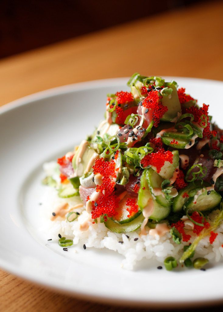 """The tuna poke is one of seven entree salads at Hero. Culinary director Danyele McPherson says salads are some of her favorite menu items. (Example: """"This taco salad is the truth,"""" she says of the $17 meal served inside a 12-inch crispy tortilla shell.)"""