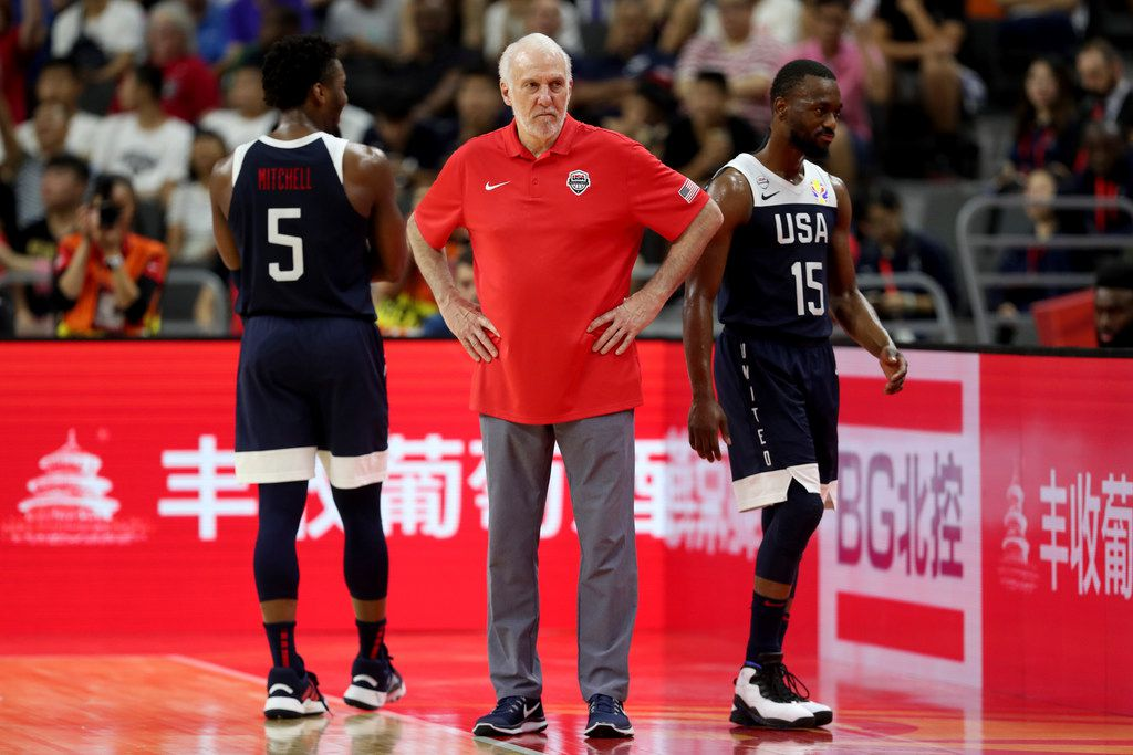 United States' coach Gregg Popovich, center looks on near United States' Donovan Mitchell , left and United States' Kemba Walker at right during a consolation playoff game for the FIBA Basketball World Cup in Dongguan in southern China's Guangdong province on Thursday, Sept. 12, 2019.