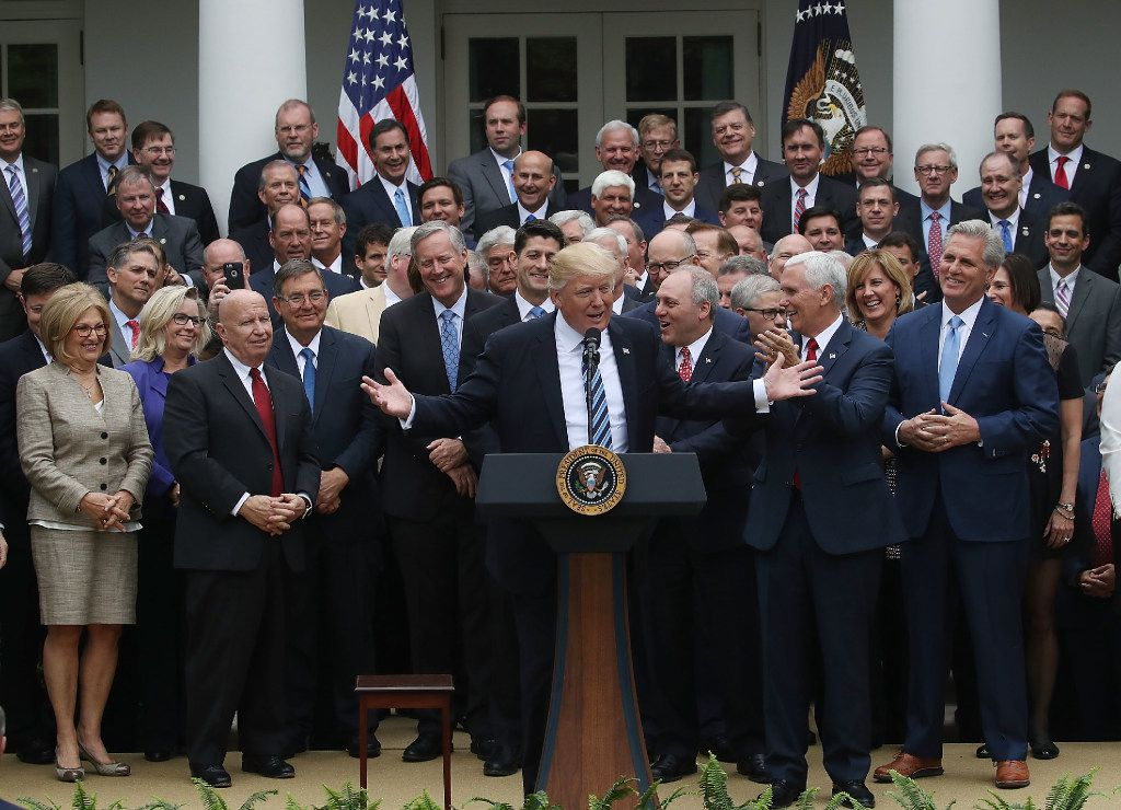 President Donald Trump speaks while flanked by House Republicans after they passed legislation aimed at repealing and replacing the Affordable Care Act.