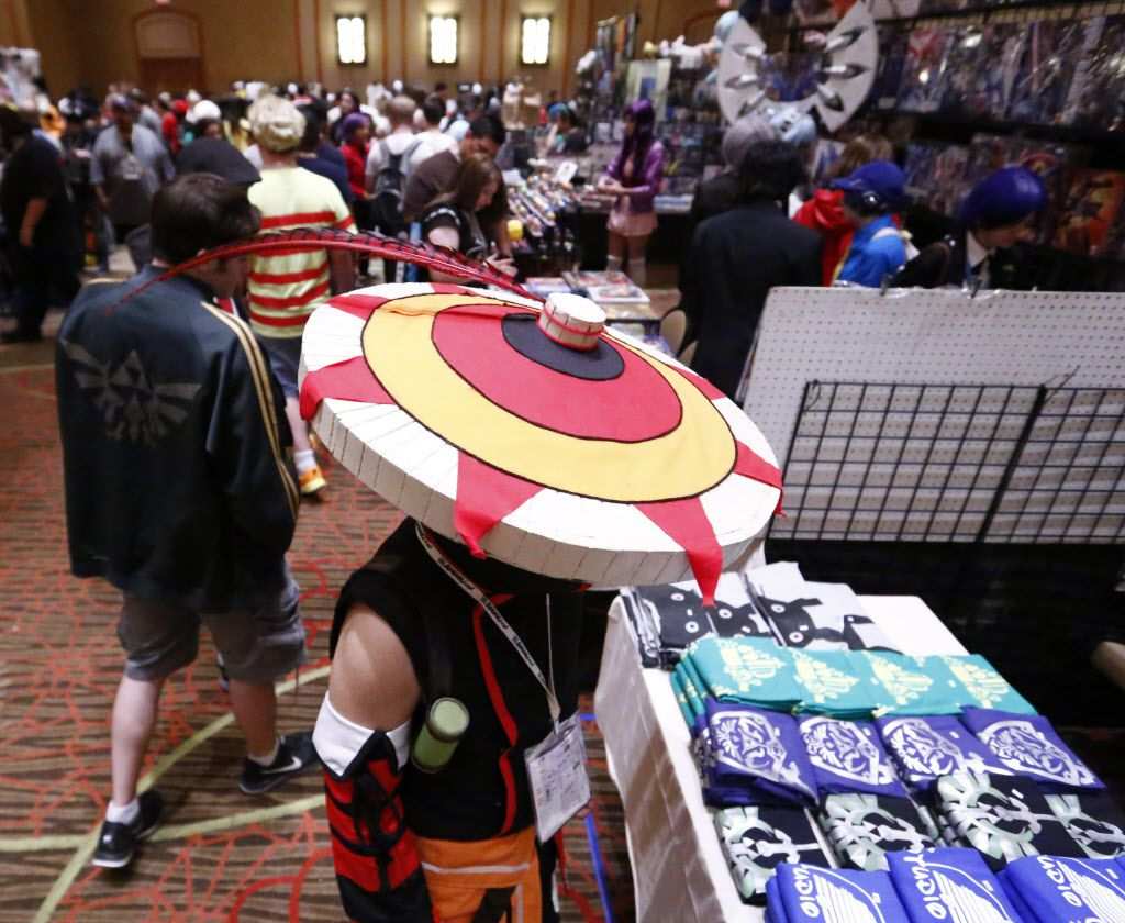 Miguel Collazo as a Monster Hunter from the Monster Hunter game looks at the merchandise available for purchase in the dealers room at AnimeFest 2015.