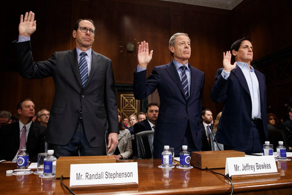 From left, AT&T Chairman and CEO Randall Stephenson, Time Warner Chairman and CEO Jeffrey Bewkes, and AXS TV Chairman and Dallas Mavericks owner Mark Cuban are sworn in on Capitol Hill in Washington, Wednesday, Dec. 7, 2016, prior to testifying before a Senate Judiciary subcommittee hearing on the proposed merger between AT&T and Time Warner. (AP Photo/Evan Vucci)