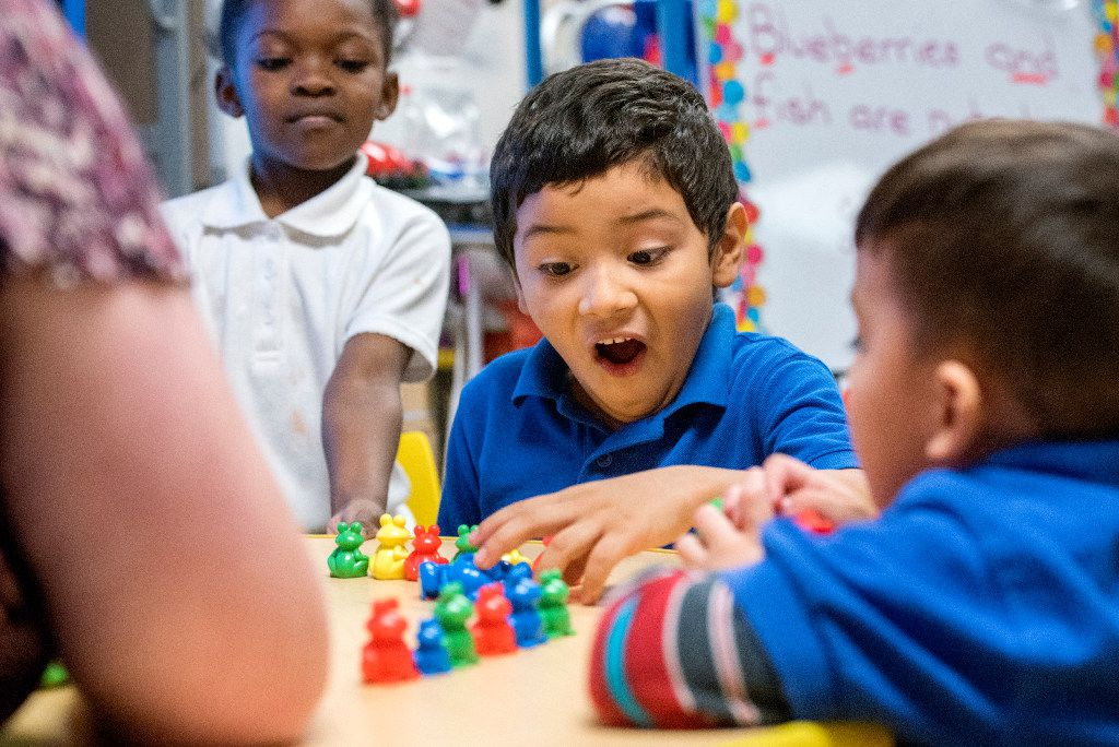 Preschooler Juan Chiquito, 5, excitedly completes a pattern during an exercise with his teacher on Friday, December 9, 2016 at Wilmer Early Childhood Center in Wilmer, Texas. (Jeffrey McWhorter/Special Contributor)