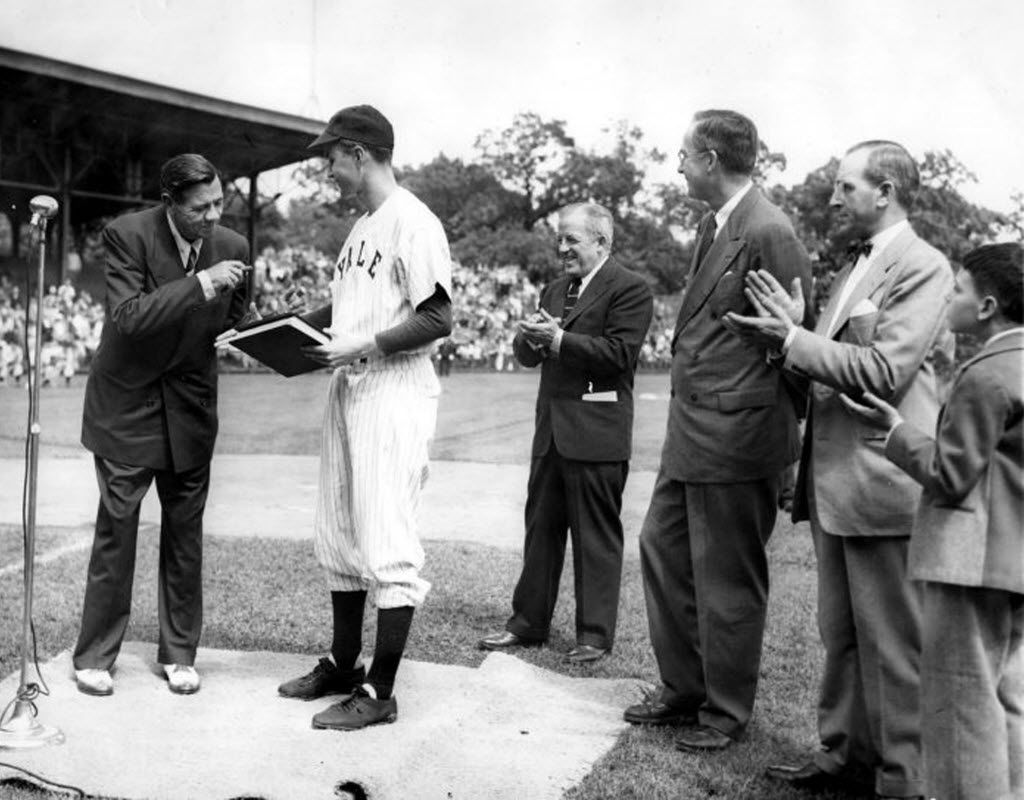 Baseball legend Babe Ruth presented the manuscript of his autobiography to Yale University in 1948. They were received by the Yale baseball team captain — George Bush (in uniform). Also present were: Bob Kiplurth, Yale athletic director; Professor James T. Babb, Yale librarian for preservation; and Mayor William Celentano and his son.