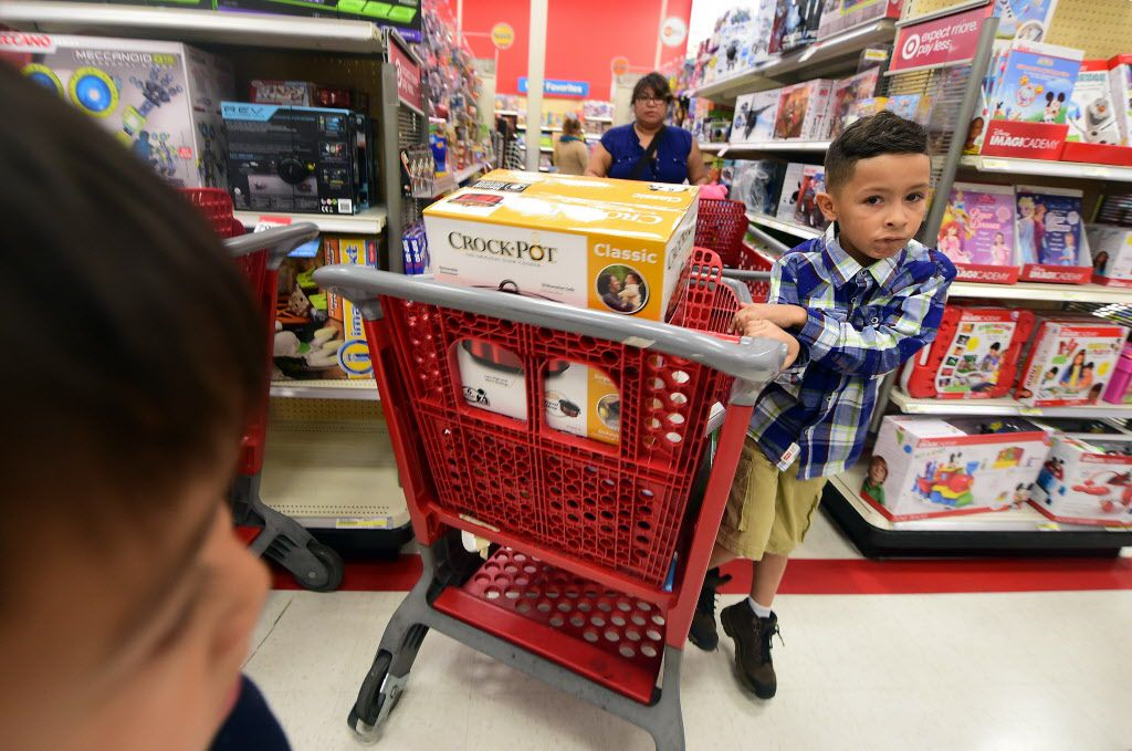 People shop for sales at a Target store in Alhambra, California, which opened at 6pm on Thanksgiving Day, November 26, 2016.