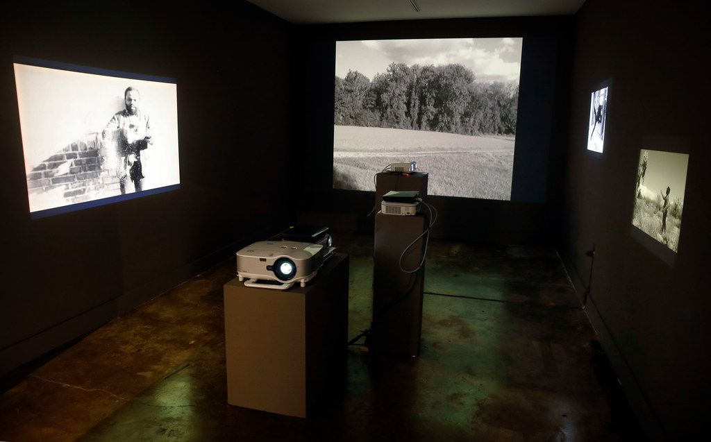 """Artist Samson Kambalu's  """"Nyau Cinema: Super Witch"""" digital films are projected in the Dallas Medianale show at The MAC gallery in Dallas, May 23, 2019."""