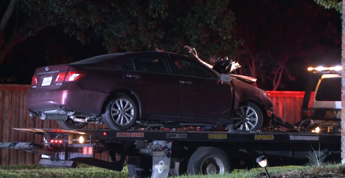 A tow truck removed a damaged car from the scene of a fatal crash Sunday night after one person died in a collision with a tree