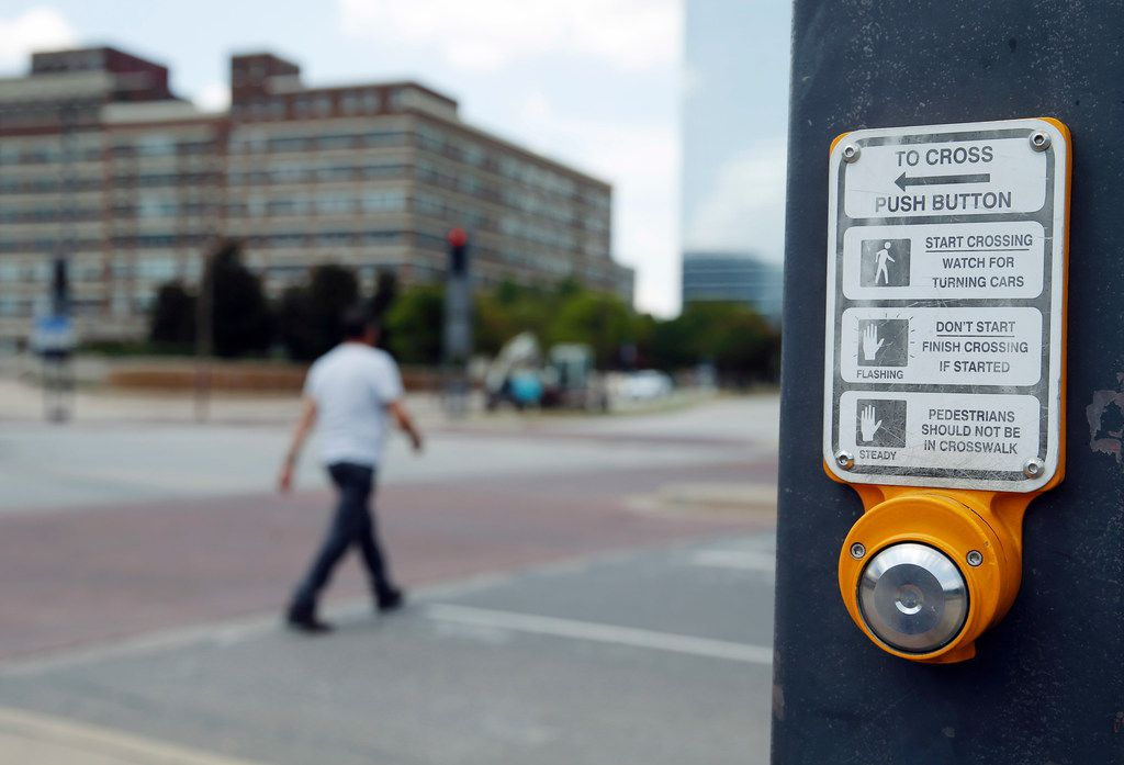 Push button for crosswalk signal in downtown Dallas on Tuesday, August 13, 2019. (Vernon Bryant/The Dallas Morning News)