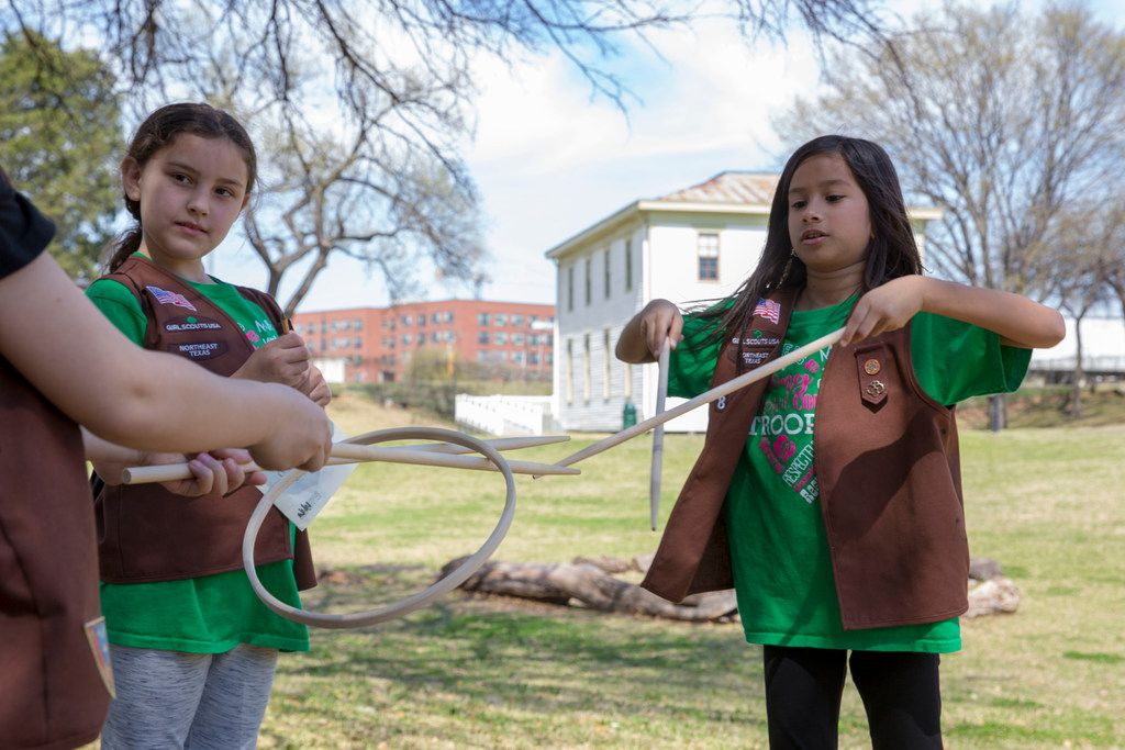 Frisco's Girl Scout Brownies Troop 8004 member Zara Khan (right) teaches fellow brownies how to play a game on Saturday, March 10, 2018, while visiting Dallas Heritage Village for Spring Fling: A Day in the Life.