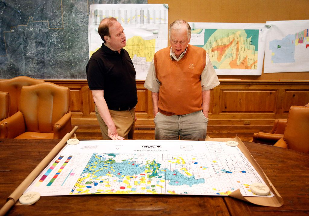 Dallas Morning News reporter Alan Peppard (left) pores over an oil and gas map with T. Boone Pickens in the boardroom on Pickens' Mesa Vista Ranch in the panhandle of Texas near the town of Miami.