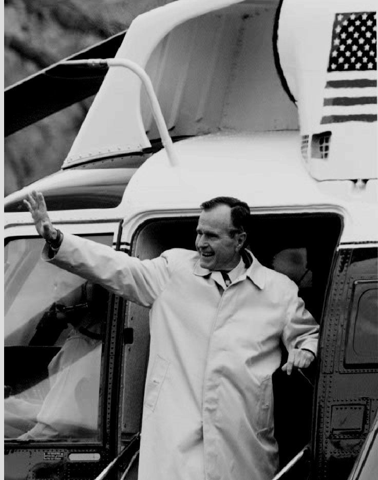 U.S. President George Bush waves to well-wishers Nov. 20, 1992, while boarding Marine One for a weekend at the presidential retreat in Camp David, Md.