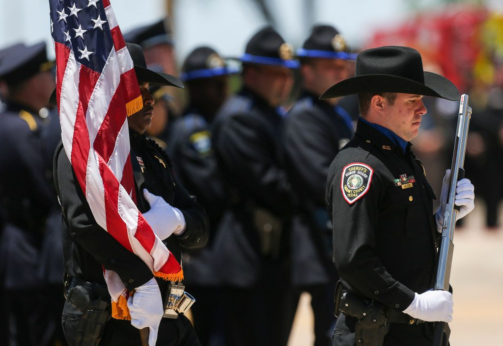 The Tarrant County Sheriff's Department's honor guard presented the colors Thursday during A.J. Castaneda's memorial services in Dallas.